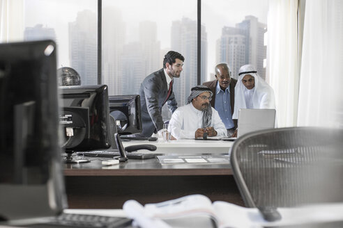 Western businessmen having meeting in Middle Eastern office - ZEF008587
