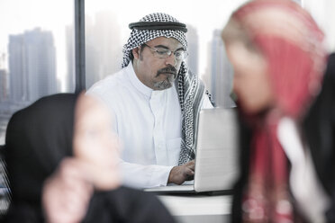 Middle Eastern man working in office - ZEF008593