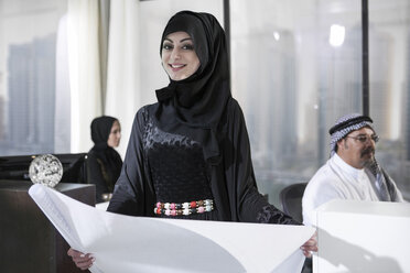 Middle Eastern businesswoman in office holding plan - ZEF008596