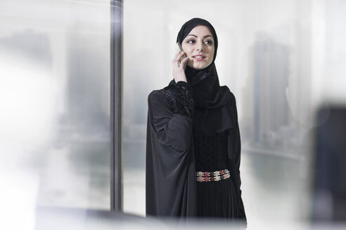 Young Middle Eastern businesswoman in office talking on the phone - ZEF008599