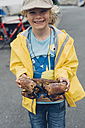Smiling boy holding great crab - MJ001812