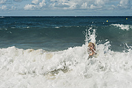 France, Brittany, Cap Frehel, Cote d'Emeraude, boy in big surf - MJF001821
