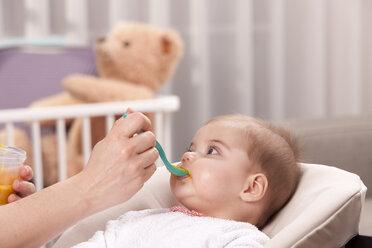 Mother's hand feeding baby girl - DSF000618