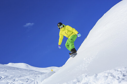 A snowboarder, snowboarding in Alps in Lech, Austria - VTF000513