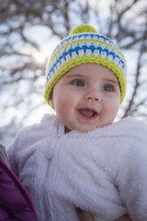 Portrait of happy baby girl wearing bobble hat - DSF000622