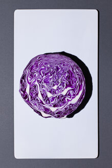 Half of red cabbage on white board - MN000153