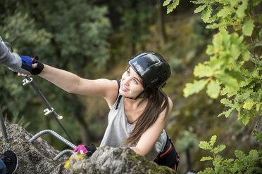 Germany, Westerwald, Hoelderstein, woman climbing on via ferrata - PAF001558