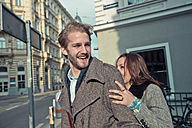 Happy young couple on the street - SUF000067