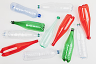 Different empty plastic bottles on white ground - GWF004639