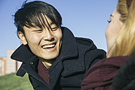 Portrait of laughing young man face to face with his girlfriend - ABZF000247