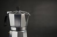 Espresso can in front of dark background - RAEF000924