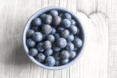 Bowl of blueberries on wood - SARF002620