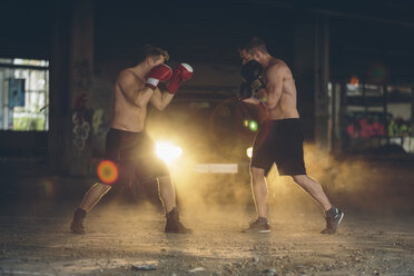 Two boxers fighting in an abandoned factory - MADF000837