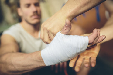 Boxer's hand is being bandaged - MADF000840
