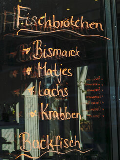 Germany, Hamburg, choice of a snack bar written on windowpane - HOHF001403