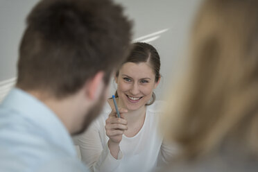 Woman smiling at colleague - PAF001577