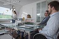 Woman leading a presentation with projector in conference room - PAF001583