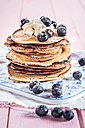 Stack of American pancakes with whipped cream and blueberries - SBDF002708