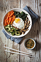 Vegetarian korean rice bowl with mushroom, spinach, cucumber, carrot and fried egg - EVGF002836