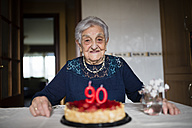 Portrait of senior woman celebrating her ninetieth birthday - RAEF000927