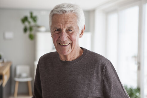 Portrait of smiling senior man at home - RBF004141