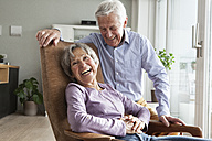Laughing senior couple at home - RBF004165