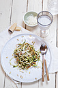 Spiralized carrot and zucchini pasta with pesto, parmesan cheese, and pine nuts - SBDF002711