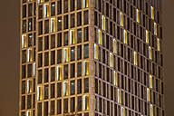 Germany, Dortmund, modern office building, illuminated in the evening - WIF003287