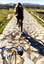 Two young women riding bicycle along a path - MGOF001506