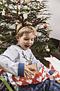 Little boy unwrapping a Christmas gift - MFF002786
