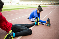 Athletes training for race in stadium - KIJF000217