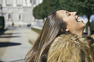 Spain, Madrid, profile of laughing women - ABZF000264