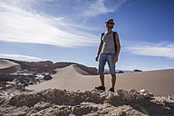 Chile, San Pedro de Atacama, Valley of the Moon, hiker in the desert - MAUF000300