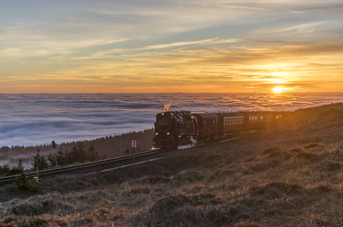 Germany, Saxony-Anhalt, Harz National Park, Brocken, Harz Narrow Gauge Railway in the evening in winter - PVCF000794