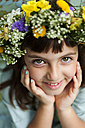 Portrait of smiling little girl wearing flowers - VABF000288