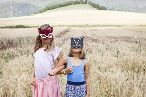 Spain, Girona, two sister playing with animal masks in nature - VABF000306