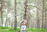 Portrait of little boy with wood stick wearing paper crown in the woods - VABF000333