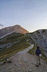 Italy, Abruzzo, Gran Sasso e Monti della Laga National Park, Hiker on the track to summit of Corno Grande - LOMF000230