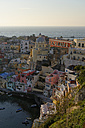 Italy, Campania, Phlegraean Islands, Procida, Marina di Corricella at sunset - LBF001411