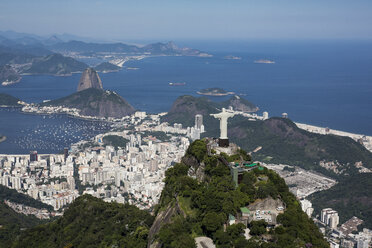 Brazil, Aerial view of Rio De Janeiro, Corcovado mountain with statue of Christ the Redeemer - MAUF000309