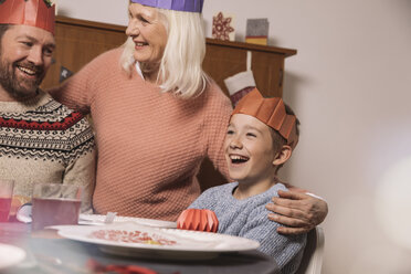 Happy grandmother, father and son during Christmas dinner - MFF002843