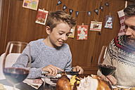 Father and son having Christmas dinner - MFF002852