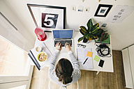 Woman working in home office - EBSF001275