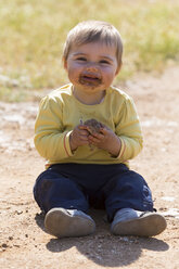 Messy baby playing with mud - DSF000638
