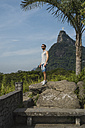 Brazil, Tourist in Rio de Janeiro with the Statue of Christ the Redeemer in the background - MAUF000340