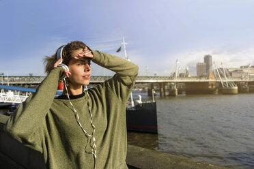 UK, London, female runner listening music at riverwalk - BOYF000131