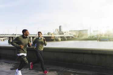 UK, London, man and woman running at riverwalk - BOYF000134