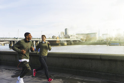 UK, London, man and woman running at riverwalk - BOYF000134