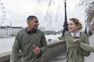 UK, London, two runners talking at riverwalk - BOYF000146