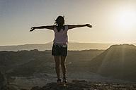 Chile, San Pedro de Atacama, woman in the Atacama desert with outstretched arms - MAUF000366